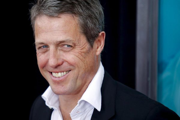 """11 Aug 2015, New York City, New York State, USA --- Actor Hugh Grant attends the premiere of """"The Man From U.N.C.L.E."""" at Ziegfeld Theater in New York August 10, 2015. REUTERS/Eduardo Munoz --- Image by © EDUARDO MUNOZ/Reuters/Corbis"""