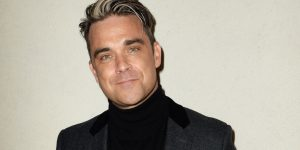 LONDON, ENGLAND - OCTOBER 21:  Robbie Williams attends The Q Awards 2013 at Grosvenor House on October 21, 2013 in London, England.  (Photo by Dave J Hogan/Getty Images)